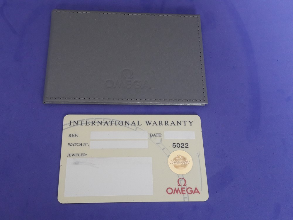 OMEGA INTERNATIONAL GUARANTEE WARRANTY CARD NEW, BLANK + CARD HOLDER